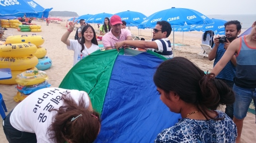 Many (senior) engineers and marketers working together to set up a simple tent x)