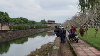 Men fishing in the moat o.o